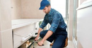Hardy Plumbing service technician installing bathtub